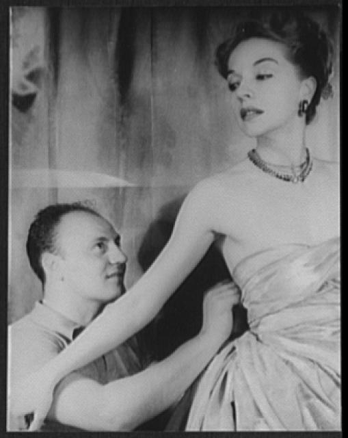 [Portrait of Pierre Balmain and Ruth Ford making a dress]