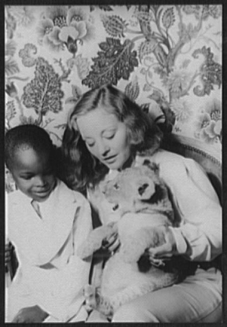 [Portrait of Tallulah Bankhead, and Julius Perkins, Jr., with lion cub Winston Churchill]