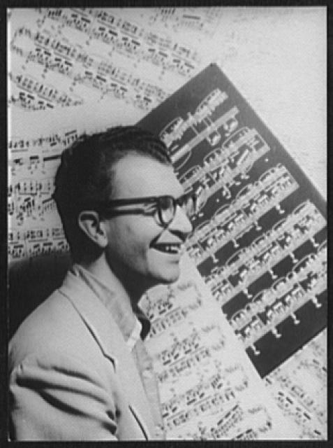 [Portrait of Dave Brubeck, with sheet music as backdrop]
