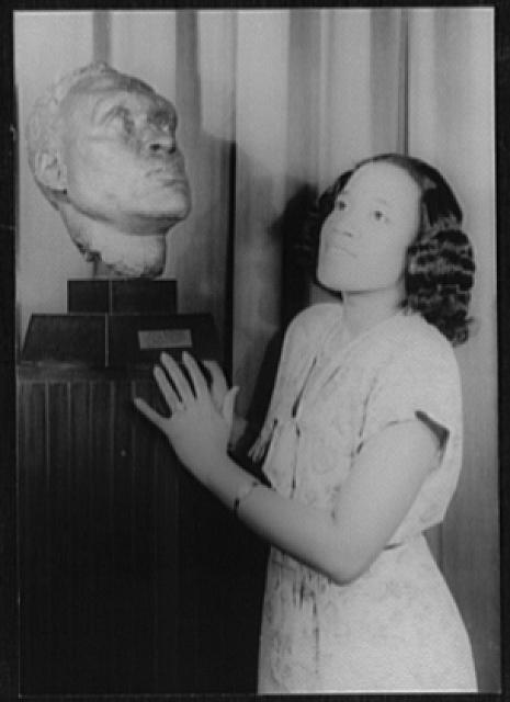 [Portrait of Camilla Williams, with Jacob Epstein's bust of Paul Robeson]
