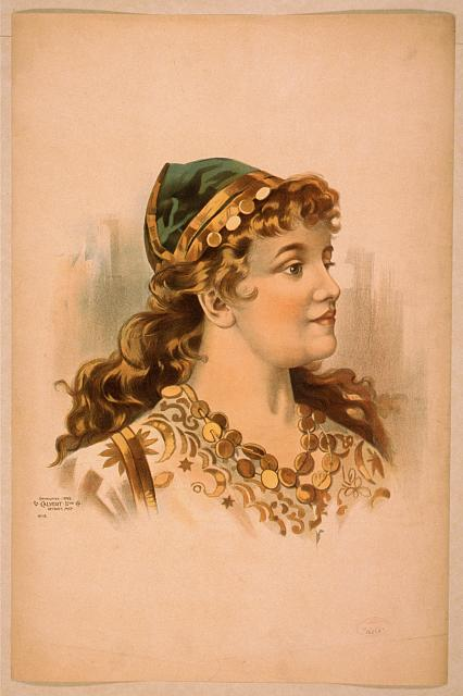 [Head-and-shoulders image of blond woman, facing right, wearing gypsy like clothing]