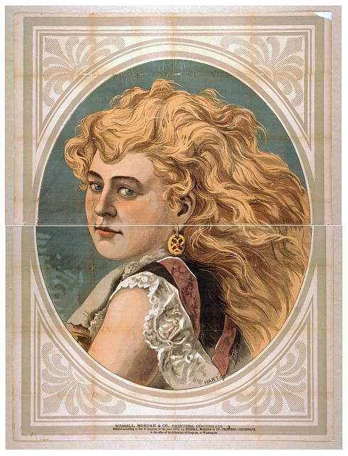 [Bust view of woman with long, blond, free-flowing hair, wearing lace]