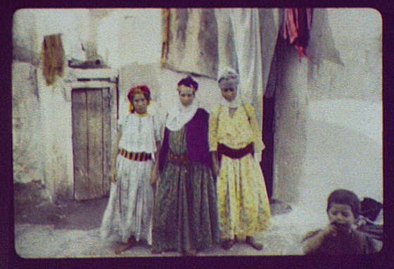North Africa (?) three women standing