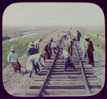 Workmen repairing railroad track