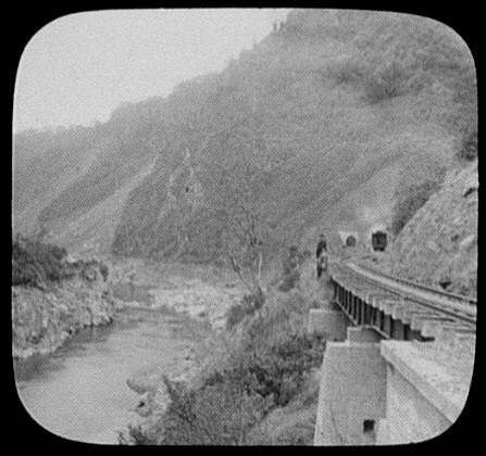 Train leaving tunnel along Manawatu Gorge