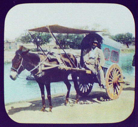 Peking - Pangborn seated on horsedrawn cart