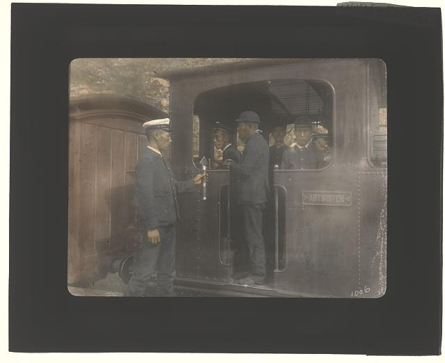 Five Japanese men on railroad locomotive