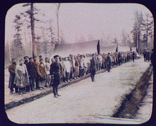 A company of convicts lining up for roll call